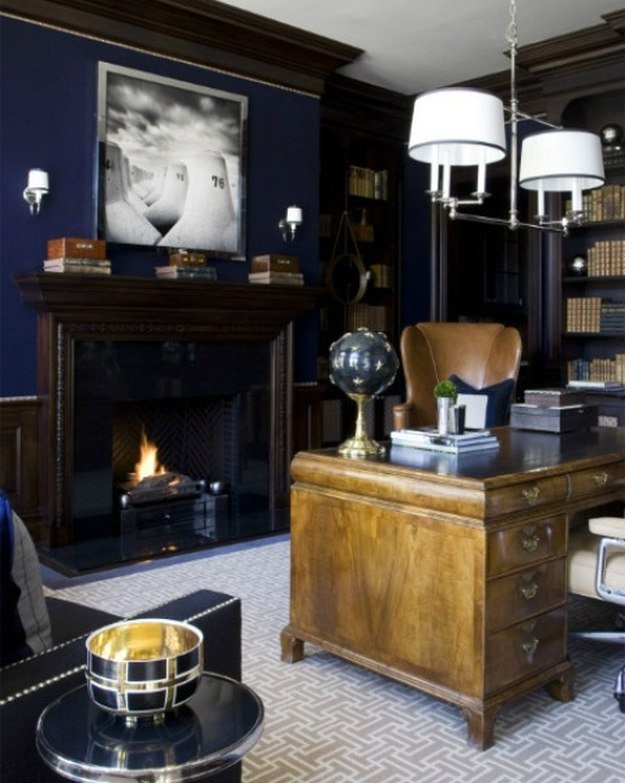 Dark navy walls make a bold impact in your men's office. A dark den or lounge with blue walls and authentic wood leather furnishings. | 10 Man Cave Ideas For Real Men