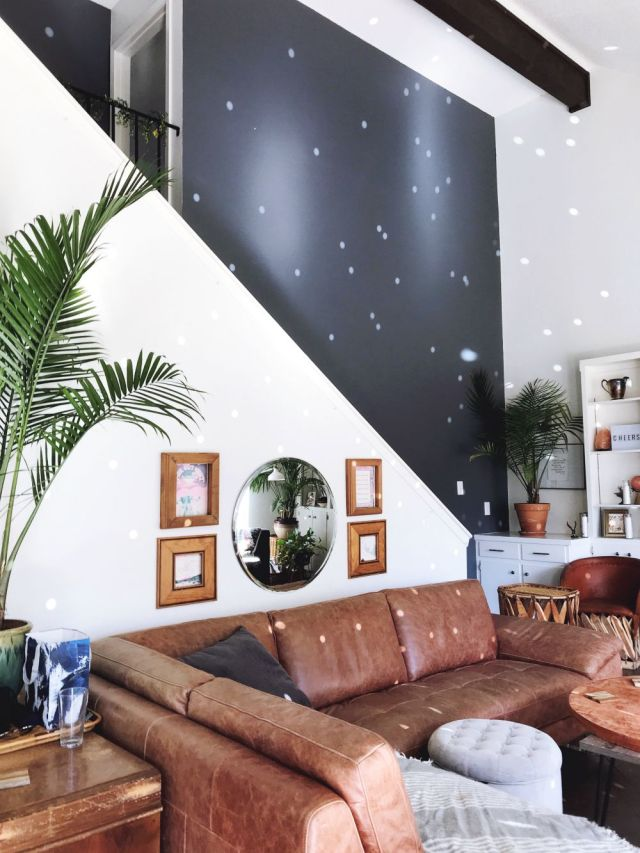 bohemian mid-century modern living room with vaulted ceilings, red leather couch, and disco ball light flare! #jungalow - Lisa's BohouHouse @BohoHouse_ATX