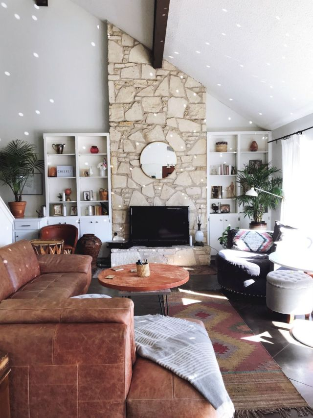 Modern Bohemian Cozy Living Room with vaulted ceilings, stone fireplace, leather furniture, disco ball lights - Lisa's BohouHouse @bohohouse_ATX